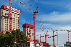 Cranes works and multistorey building Stock Images