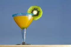 Crange Cocktail. With Kiwi. Blue sky background Stock Photos