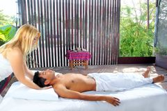 Cranial sacral massage therapy in Jungle cabin. Tropical rainforest Royalty Free Stock Image