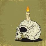 Cranio con la candela Fotografia Stock