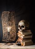Cranio con la lampada fotografia stock