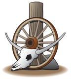 Cranio del manzo contro la ruota di vagone fotografie stock libere da diritti