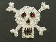 Cranio, fatto di riso e dei condimenti Fotografia Stock