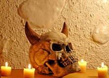 Cranium with four candles. Fake dangerous cranium with four candles royalty free stock image