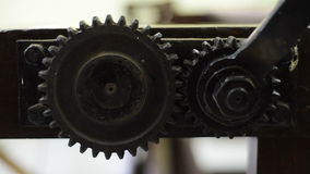 Crank turning two gear wheels stock video