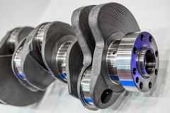 Crankshaft of an internal combustion engine. Main part of the automobile engine stock images