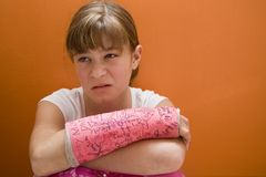 Cranky Girl. Photo of Maggie in a pink cast Stock Photo