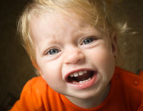 Cranky little girl. Little girl's face is very very cranky Royalty Free Stock Photography