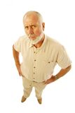 Cranky old man. Grumpy old man looking suspiciously into the camera with doubt and misgivings; great conceptual shot for retirement, aging, etc Royalty Free Stock Images