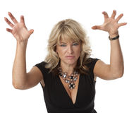 Cranky Woman in Menopause. Waist up view of woman in a bad mood on white background Royalty Free Stock Image