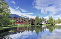 Crans-Montana, Valais, Switzerland. Chalets and lake at Crans-Montana by beautiful day, Valais, Switzerland Royalty Free Stock Photo
