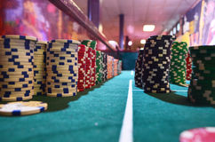 Table at eye Level. View of a table from eye level of a stack of poker chips royalty free stock photography