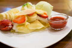 Crape with banana, strawberry and ice cream Stock Photo