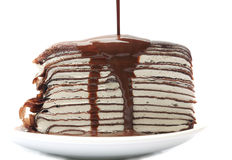 Crape cake with chocolate sauce pouring Stock Photo