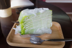 Crape cake. Dressing coconut sauce on wood dish,on table stock images