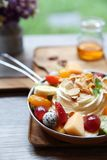 Crepe cake with fruit. On a pan royalty free stock photos