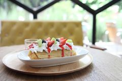 Crepe cake with fruit. On wooden plate royalty free stock photography
