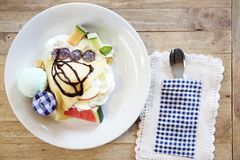 Crepe cake with fruit. And ice cream royalty free stock photography