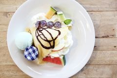 Crepe cake with fruit. And ice cream royalty free stock photos