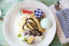 Crepe cake with fruit. And ice cream royalty free stock photo
