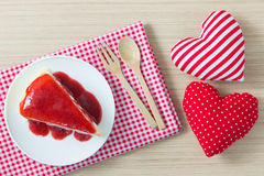Crape cake pour with strawberry sauce on plate and decoration hearts Stock Photography