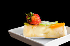 Crape cake roll with fruit. On black background Royalty Free Stock Photo