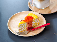 Crape cake and strawberry jam on wooden dish. Strawberry yam and crape cake on wooden dish Stock Images