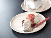 Crape cake and strawberry jam on wooden dish. Strawberry yam and crape cake on wooden dish with vintage color effect Stock Photo