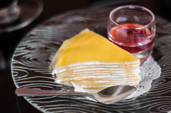 Crape cake with strawberry sauce. On glass dish Stock Photography