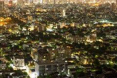 Crapers dei citys di Bangkok con alta costruzione alla notte Immagini Stock Libere da Diritti