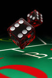 Craps dice. Two dice over a craps table with selective focus Stock Photo
