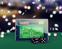 Craps online. Tablet pc with a craps app and a couple of dice, game chips falling on background (3d render Royalty Free Stock Photos