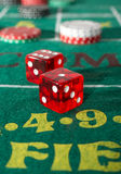 Craps Table. With casino chips and dice Royalty Free Stock Photos