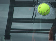 Crash. Baseball imbedded in rear window of truck royalty free stock image