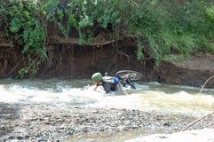 CRASH !!. Boy crashs in water on mountain bike royalty free stock photo