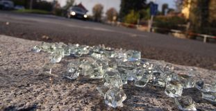 Crash aftermath. Scattered glass on the road stock photos