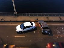 Crash or auto accident on the bridge, top view. Crash or auto accident on the bridge, collision of two cars, top view stock photos