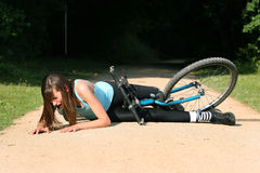 Crash with bike. Female bike rider takes a tumble and crying in pain on the ground Stock Images