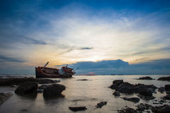Crash boat on sea during sunset Royalty Free Stock Photography