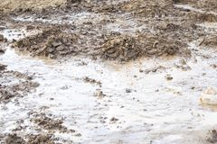 Crash. breakthrough plumbing. it flows into the street. dirt and sand are formed. consequence of repair. Accident leakage water washed ground road flooded marsh royalty free stock photography