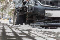 Crash a broken car in winter on the road under the snow. royalty free stock photography