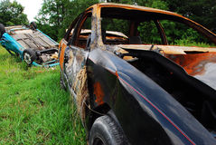Crash and Burn. Once great cars now left for the junk man. Burned and Crashed Royalty Free Stock Images