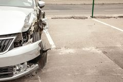 Crash car in front after the accident. Broken wing and wheel, bumper and undercarriage. Copy space. For text Royalty Free Stock Image
