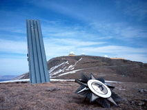 Crash of the Empire. Destroyed soviet obelisk somewhere in Caucasian mountains Stock Image