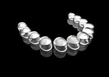 Crash helmet teeth. 3D render of crash helmets forming row of teeth Royalty Free Stock Images