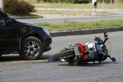 Crash moto bike and car on road Stock Photo
