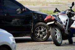 Crash moto bike and car on road Stock Photos