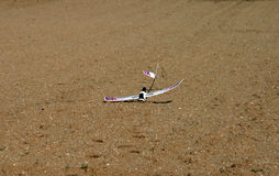 Crash of a RC model. Plane RC model crashed in the middle of a field Royalty Free Stock Image