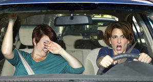 Crash. Reckless driver and scared female passenger in a car royalty free stock photos