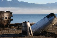 Crash site 034. Commercial aircraft crash site on beach with fog sea and mountains in background (props for film set Stock Photo
